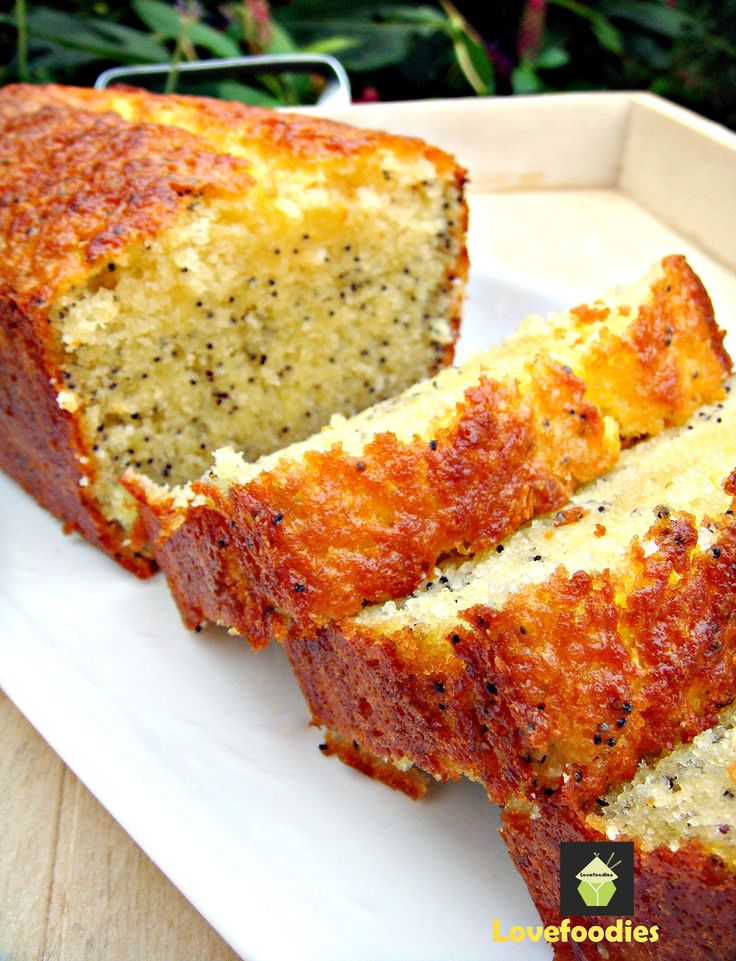 Moist Lemon and Poppy Seed Loaf. A wonderful gentle flavored, soft cake, perfect with a cup of tea! #cake #lemon #poppyseeds #baking