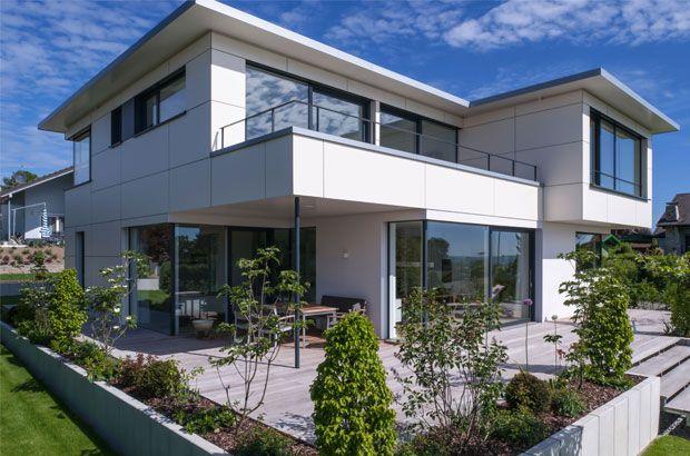 Individuell geplantes Architektenhaus in Holzständerbauweise von KitzlingerHaus