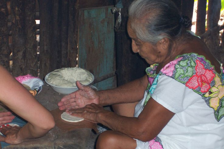 This women work all day long,making tacos for the family in her mayan village