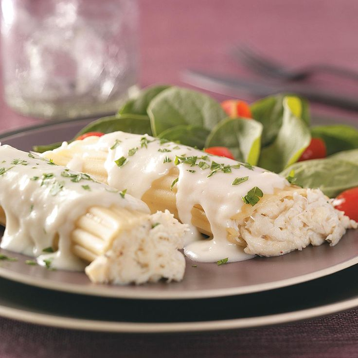 Crab-Stuffed Manicotti Recipe -I love pasta, and my husband loves seafood. I combined them to create this dish, and he raved that it's the best meal ever. —Sonya Polfliet, Anza, California