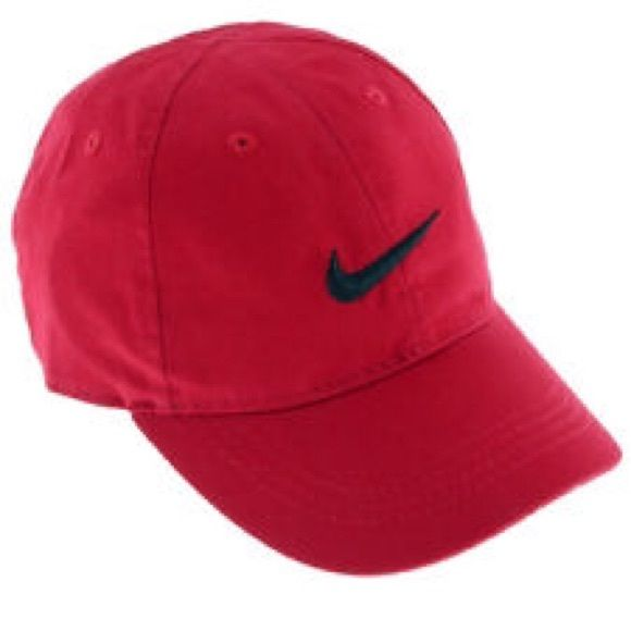 Red Nike hat Red Nike hat. The tag says size 4-7 which I didn't notice until I took the photos for this listing, not sure if that means children's? I am 21 and the hat fits me great so I'm unsure. Selling because I have 2. Nike Accessories Hats