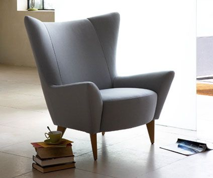I need a high back (yet stylish!) chair for when my mum comes to stay....she gets a sore neck if her head's not supported. Quite like....    Google Image Result for http://modculture.typepad.com/photos/uncategorized/2008/12/05/steinbeck.jpg
