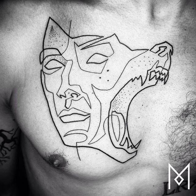 Tatuaje inspirado en la tapa del libro Steppenwolf de Hermann Hesse, elaborado utilizando una sola línea.