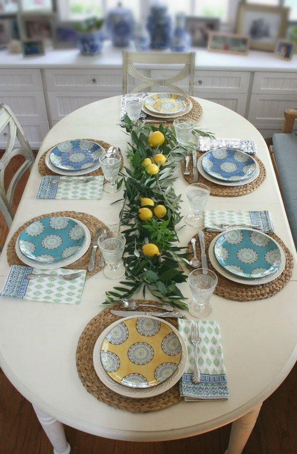 How to set the table with fresh herbs and lemons to create an italian style tablescape.