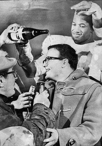 Bobby Bell pouring champagne on Lamar Hunt