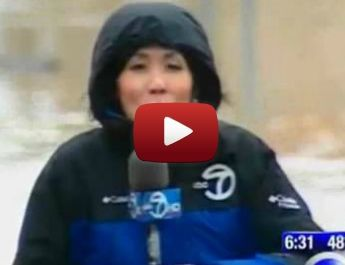 Passing pedestrian ruins the dramatic effect of exaggerated flood report