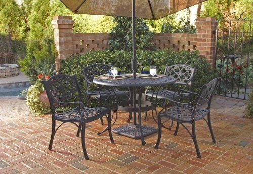 "Biscayne 5 Piece Round Outdoor Dining Set Black by Home Styles. $1300.04. Center opening accomdates umbrellas. 5 piecc set. Nylon glides on all legs. Round table. Attractively patterend table top. Home Styles Biscayne 5PC Set includes 42"" Round Outdoor Dining Table and Four Arm Chairs. Set is constructed of cast aluminum with a Black finish. Features include hand antiqued powder coat finish sealed with a clear coat to protect finish, attractively patterend table top has..."