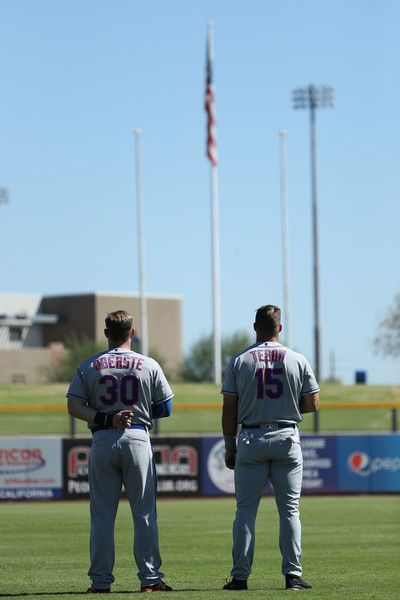 Matt Oberste #30 (New York Mets) and Tim Tebow #15 (New York Mets) of the Scottsdale Scorpions stand for the national anthem before the Arizona Fall League game against the Peoria Javelinas at Peoria Stadium on October 13, 2016 in Peoria, Arizona.