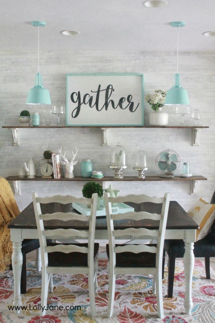 Gorgeous farmhouse dining room. All the tips to achieve this look without breaking the bank! Love the aqua dining room accents and the farmhouse pendants too! Pretty neutral dining room ideas!