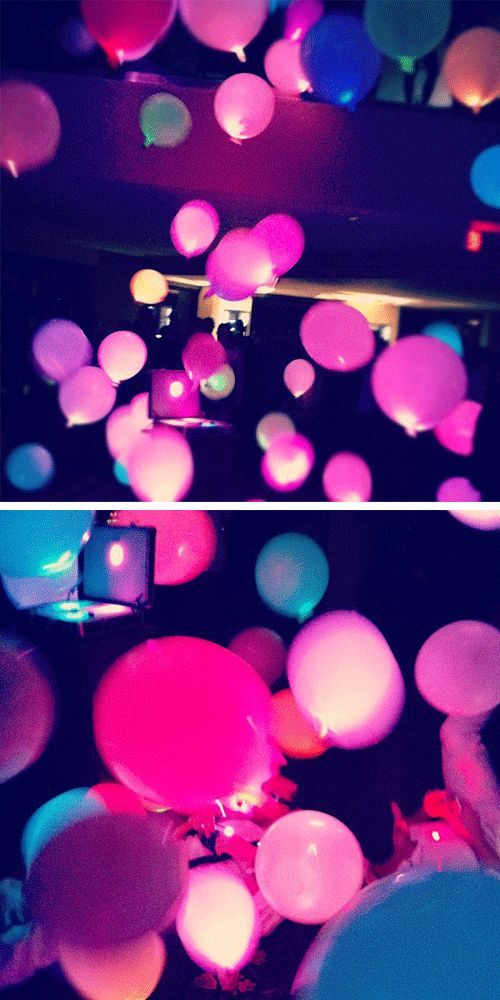 Light colored balloons with black lights