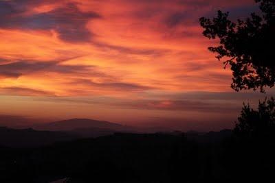 Orange and purple sunset over Le Marche hills