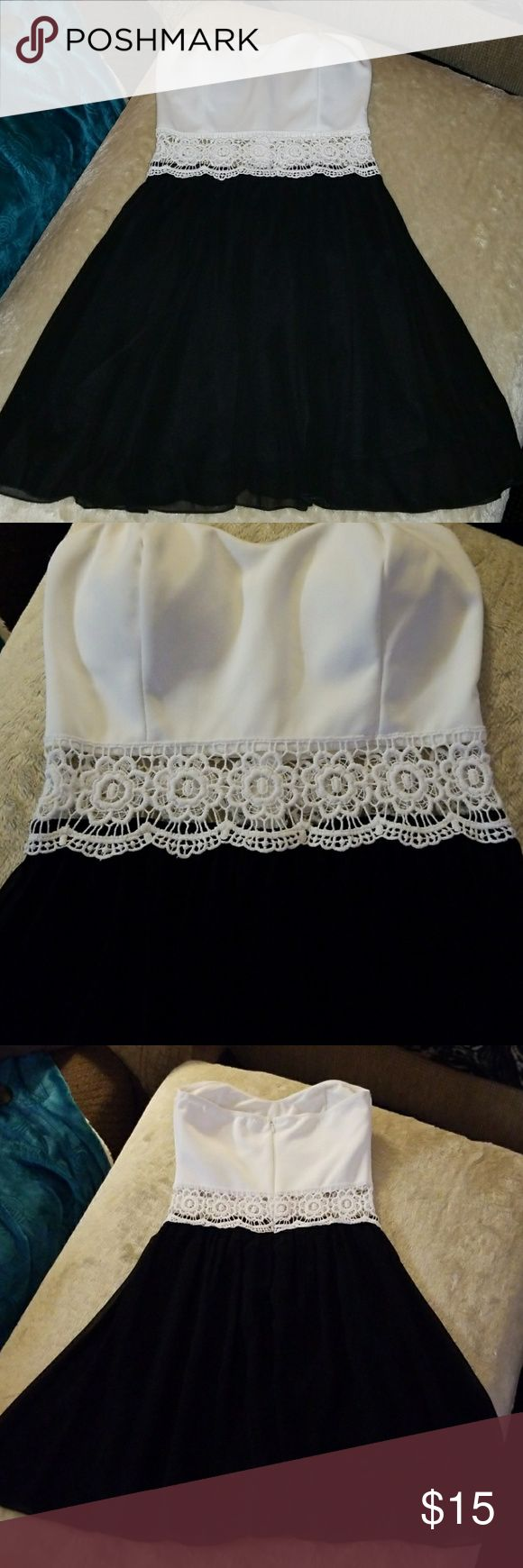Lady's or Jr's Strapless Black & White Mini-Dress Excellent condition! Like New! Strapless dress with small padded breast cups (size 32 A), is my guess. Sheer skirt with liner, see-thru waist , and white bodice! 95% polyester and 5% spandex. Hand wash cold, line dry. Super cute. See picture for length from breast to hem line. Just Me Dresses Mini