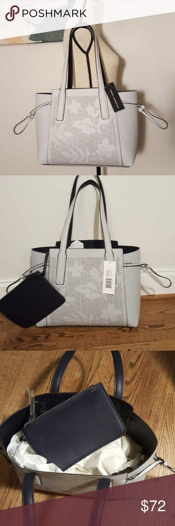 "French Connection Alison Tote - Mineral Grey Very Classy French Connection ""Alison"" Tote in Mineral Grey. Comes with attached zipper pouch that's is about 5.75""x8.5"". Bag measures 14""x 5"" at bottom but expands out a bit at the top.  Sides can cinch closed. French Connection Bags Totes"