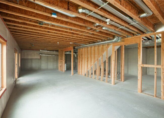 The Pros And Cons Of Finishing Your Unfinished Basement Framing A Basement Finishing Basement Walls Basement Walls