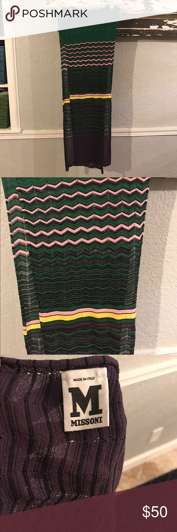 Missoni scarf stunning ! Purples, pinks , greens ,yellows.  So beautiful and on trend. Great preowned condition.Approx 70 inches.   Nice and long Missoni Accessories Scarves & Wraps
