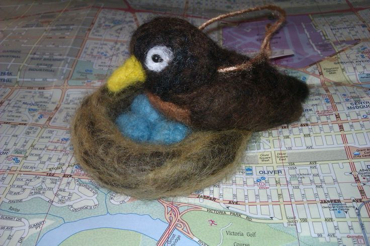 """""""Skye"""" the Robin; 2014; needle felted sculpture by Holly Boone of Polar Lights Art Studio. Currently located at the Alberta Craft Council. - SOLD! http://polarlightsart.wix.com/plas#!hollys-work/cq0w"""
