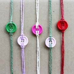 Make your own button bracelets! @Ali Newton for next time you go to friendship bracelet camp :)
