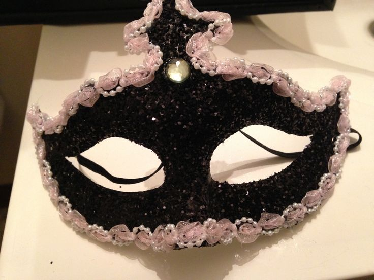 Masquerade Mask! I bought a plain white mask at hobby lobby, I painted it black, put glitter on the mask, hot glued the pink border & stuck a sliver gem to my mask.