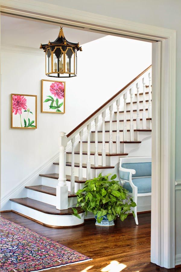 This classic entryway gets all of the details right, like the color antique rug and custom artwork.