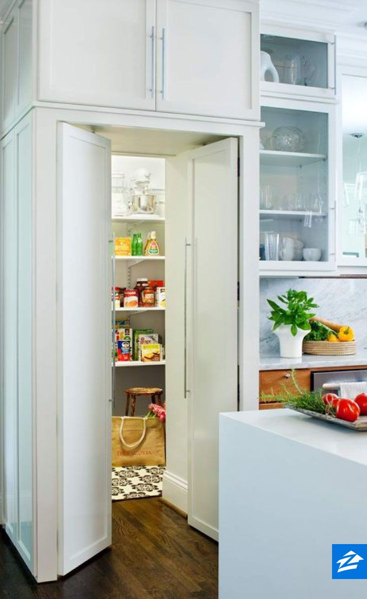 Tucked behind the kitchen, this pantry is the perfect place to keep spices and dry goods neat and organized.