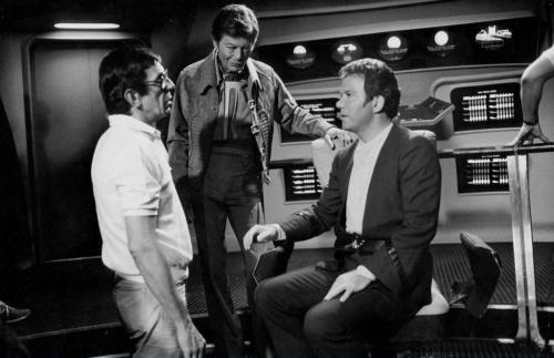 Leonard Nimoy talks to DeForest Kelley and William Shatner during the filming of Star Trek III.