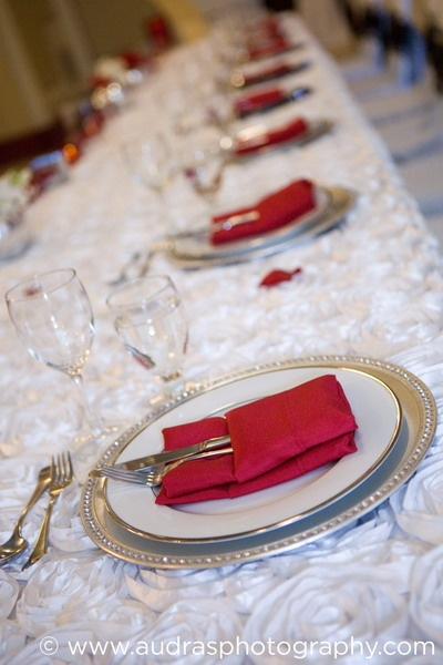 Red table linens on white table cover at a Heritage Hall wedding in Vancouver. Planning by Eventful Planners, decor by Niche Event Stylists.