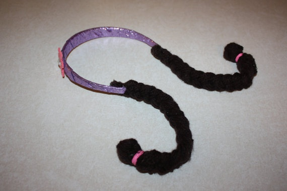 Doc McStuffins headband, with braids. I could make this!