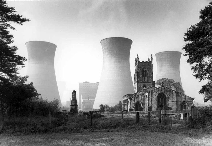 John Davies photography the British way of live. The image symbolises old and new. The different scales of the church compared to the industrial power plants. It represents a change in human society.
