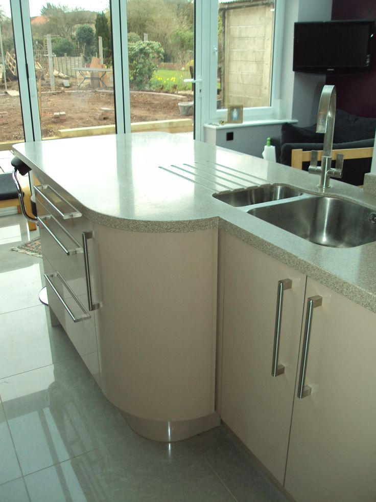 Cappuccino gloss, Rangemaster taps with and Corian curved solid surface tops...