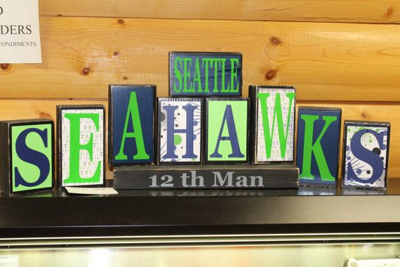 wooden Seahawks sign