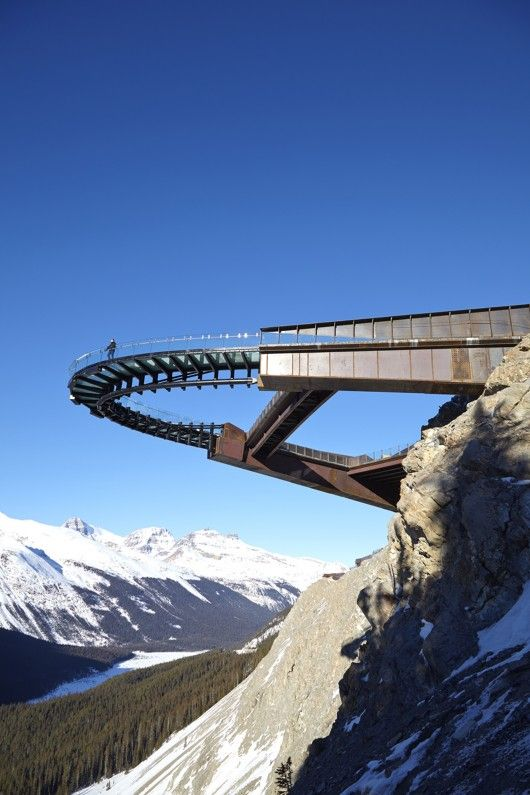 Architects: Sturgess Architecture 2014 Location: Jasper National Park, Jasper, Canada  The Glacier Skywalk is a 1475-foot long (450-metre) interpretive walk carved and folded into the mountainous landscape of Jasper National Park in the Canadian Rockies. The corten steel and glass structure cantilevers outward, overlooking the Sunwapta Valley and facing the Athabasca Glacier situated in an icefield straddling the Continental Divide.