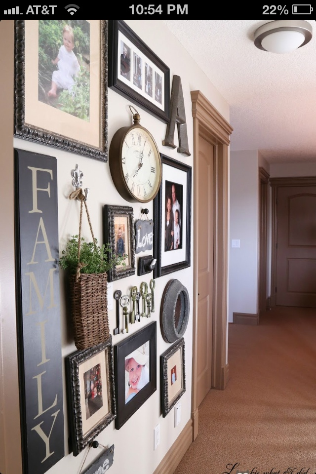 Add other items  (such as clocks or baskets) in among your family photos to create interesting displays.