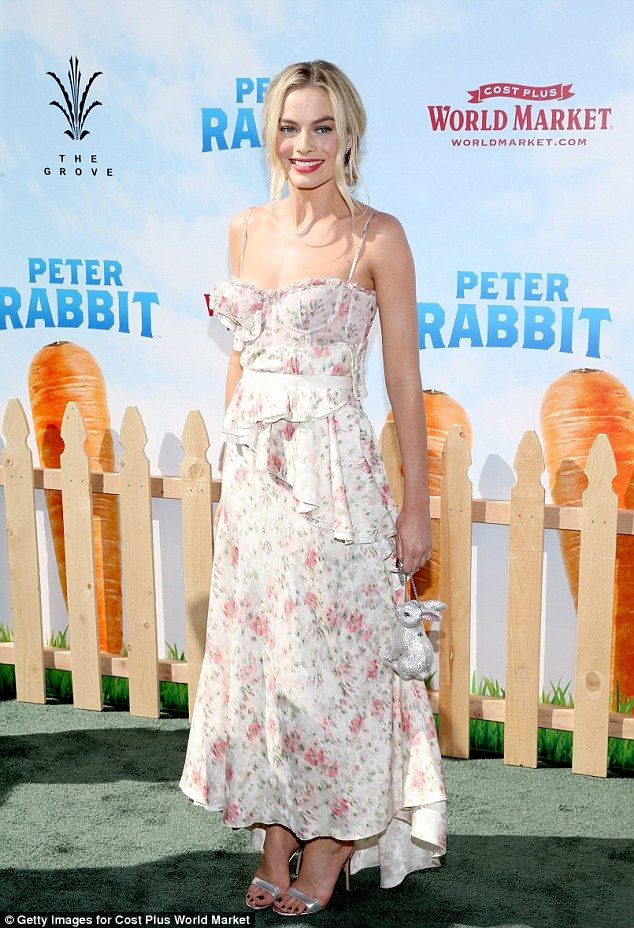 Wonder in white: Margot Robbiestunned in a white floral dress at the Peter Rabbit premiere in Los Angeles on Saturday