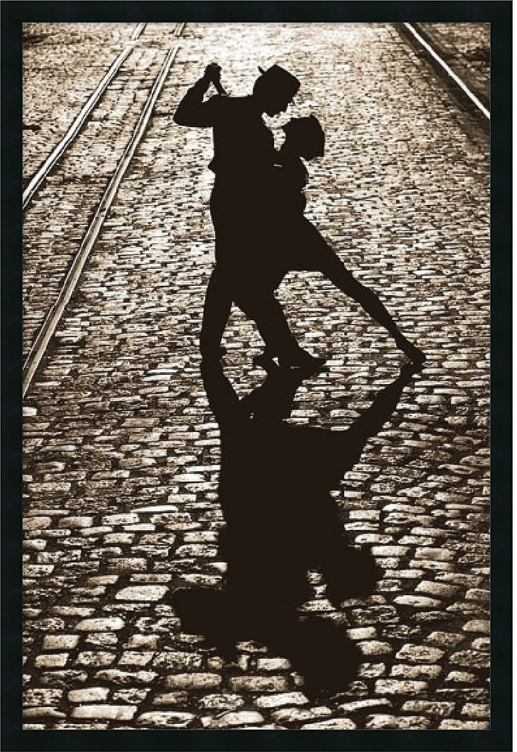 A Dramatic Black And White Print Captures Forever The Silhouette Of Two Dancers In The Passionate Final Pose Of A Tango. Their Shadow Stretches Out On The Cobblestone Street. - Artist: Unknown - Title