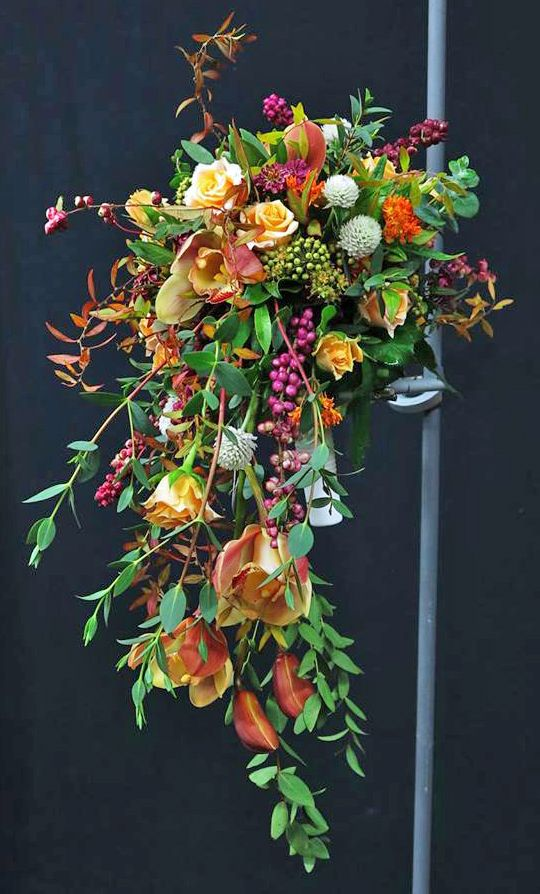 Gorgeous, contemporary, loosely constructed, crescent bridal bouquet. Oh Myeon Floral Art School • photo Andreas Faber