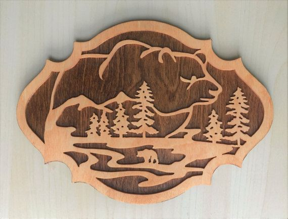 This bear nature scene is a wooden plaque to hang on your wall.  Get just this one for $40 or get a set of three for $100.