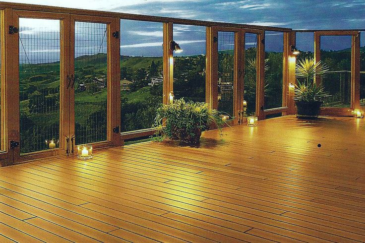 Plexi glass panels accent wooden deck outdoor for Garden decking glass panels