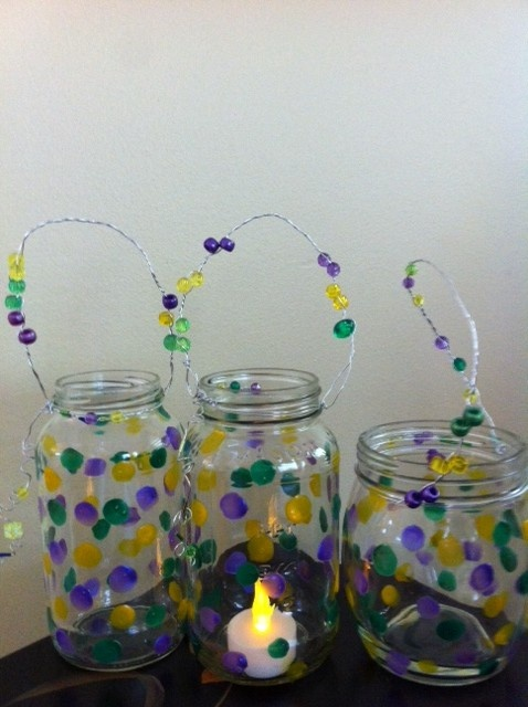 Mardi Gras garden lights for led candles, made of spaghetti sauce jars, glass paint, jewelry wire, and beads.