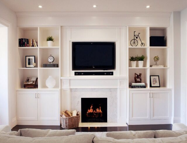 Ideas for contemporary fireplace with built-ins and TV nook. Love the simple design/style of the built-ins.