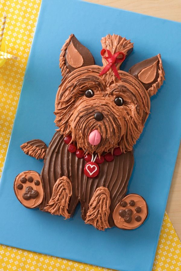 """A sassy little Yorkie is sure to be the star of any pet-lover's party. Click to get the downloadable template, which makes cutting the shapes a snap! Betty member Winstonsuz says, """"The easiest part was cutting out the pieces and assembling the cake…no problem! Thanks for the cute doggie cakes!"""""""
