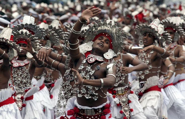 traditional costumes perform during a street parade in central Colombo, Sri Lanka