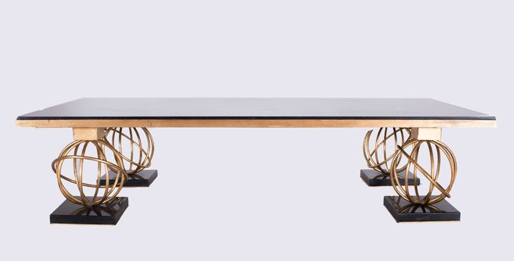 Jean ROYERE (1902-1981) Sphere model,circa 1950 Low Coffee Table  Constructed of gold painted metal with a black marble top  Editions SA 59 x 27.5 x 13.75 in. - 150 x 69.5 x 35 cm.
