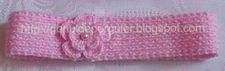 Hand knitted baby hairband with pearls and crocheted flowers