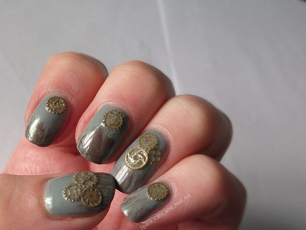 Cog steampunk nails!   Studs - born pretty store  Gray - OPI I Can Never Hut Up  Brown – OPI Over the Taupe with some Sally Hansen xtreme wear - 370 black out mixed in  Top coat - Maxfactor Glossfinity 05 top coat  Top coat - Orly sec n dry  Base coat - Sally Hanson nail Rehab    #cognails #steampunk  #steampunknails #nailart #nailpolish #nailstuds #Bornprettystore #opinewzealand #OPI #nails #manni #manicure #nails