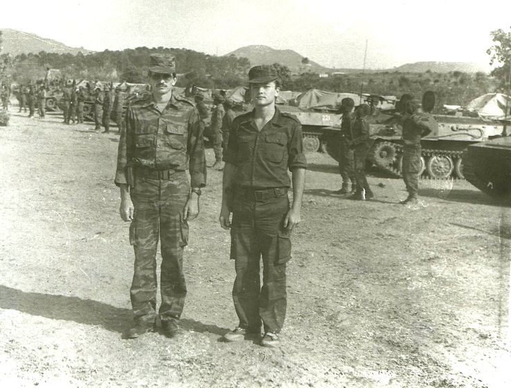 1988. Soviet officers pose in front of an Angolan Air Defense unit at the training Center in Lubango, Angola. The Angolan soldiers are graduating from their training in the use of The Strela 10 Surface-To-Air Missiles.