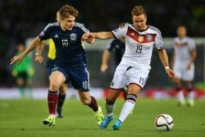 World champions Germany kept hold of top spot in Group D and moved to the verge of Euro 2016 qualification with a 3-2 defeat of a spirited Scotland side at Hampden.