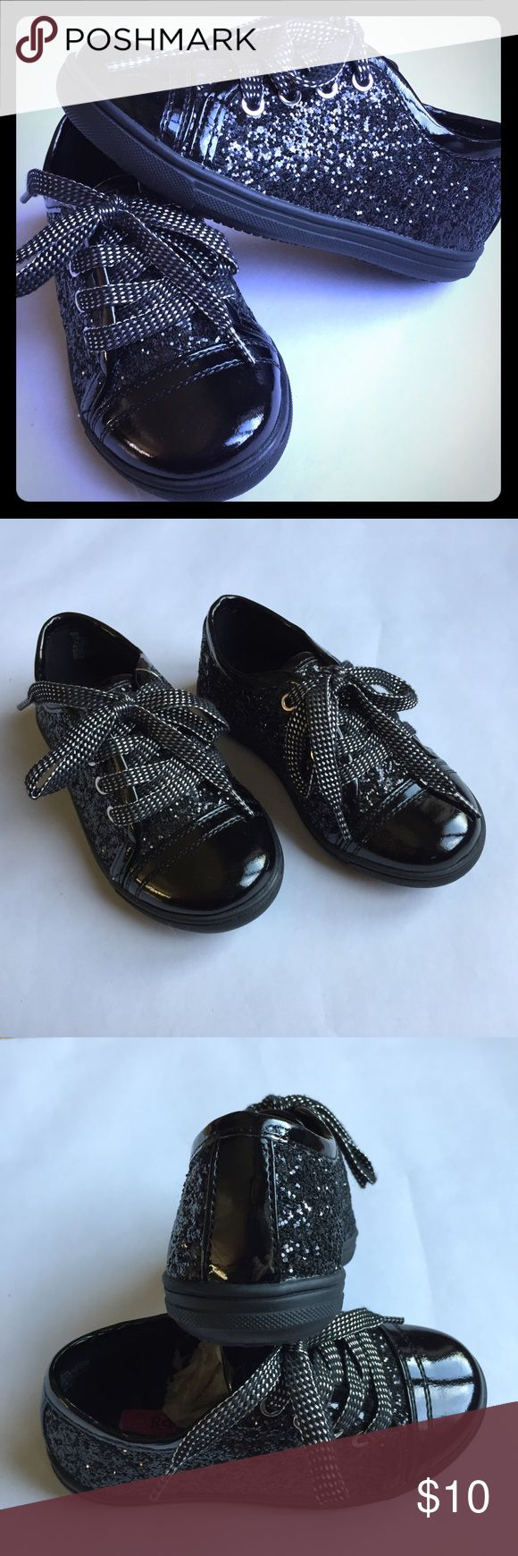 NWT Black Patten Leather & Sparkle lace Up Sneaker Brand new, never worn. Actual tag is missing but paper in shoe and plastic tag attached. Very cute, patten leather look with sparkles. Laces are black and silver glittery. Rachel Shoes brand, toddler girl size 9. Rachel Shoes Shoes Sneakers