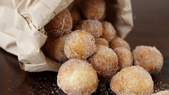 Pizza Dough-Nuts - Uses a can of pizza dough (don't unroll). Cut into 12 (1-inch) slices. Roll in ball & cook in hot oil for about 13 seconds. Drain & toss in paper bag with cinnamon sugar (1/2 c. sugar & 1 t. cinnamon)