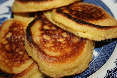Southern Cornmeal Hoe Cakes - A classic southern recipe, cornmeal hoecakes are little pan fried cornmeal medallions that are at home as breakfast, as much as they are as a side dish with a mess o' greens, and just about anything else!