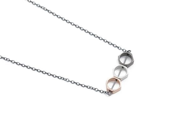 Oxidized sterling silver necklace, with hexagon shaped beads plated with oxidized brass, matte silver and rose gold.